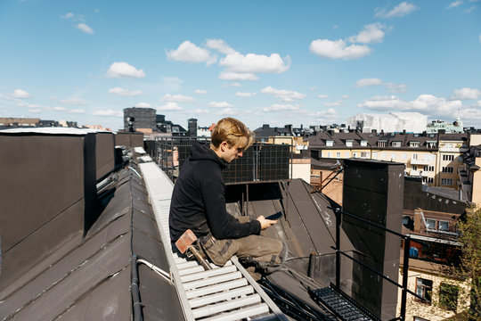 Roofer on a work break in Stockholm, Sweden