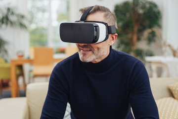 Middle-aged man experiencing VR