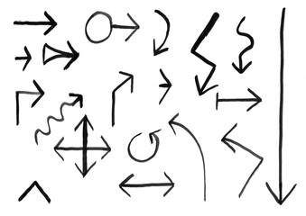Black brush and ink artistic rough hand drawing of set of arrows.