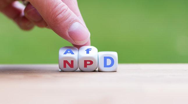 """Hand dreht Würfel und ändert die Bezeichnung """"NPD"""" in AfD"""""""