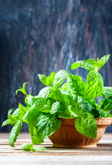 Juicy, fresh, aromatic green mint on the wooden table