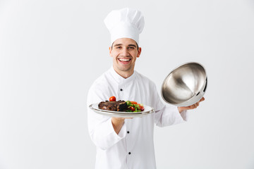 Excited man chef cook wearing uniform