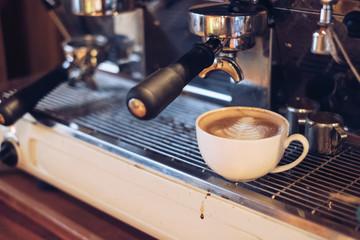 Hot Latte coffee leaf shape on coffee maker