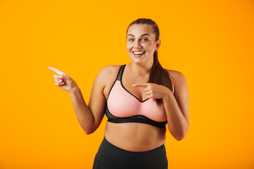 Portrait of a cheerful overweight fitness woman