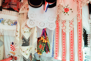 Croatian souvenir traditional tablecloths and towels sold at local market