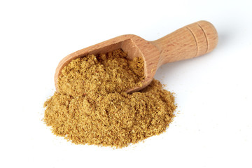 Fototapeta Ground cumin powder in wooden scoop isolated on white background obraz