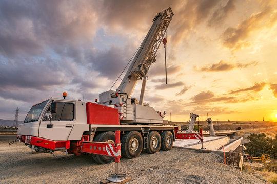 Crane trucks in the construction of a bridge