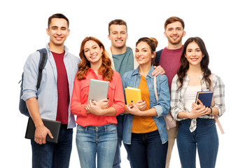 education, high school and people concept - group of smiling students with books over white background