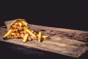 French fries Pommes Frites on Wood Dark