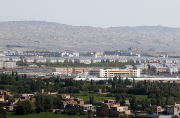 With XinjiangÕs fabled Tianshan mountains in the background, what is officially known as a vocational skills education centre is seen in Turpan