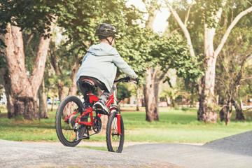 Boy riding his bicycle