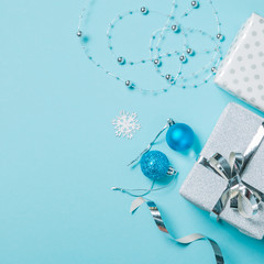 Christmas background - presents and decorations in silver and blue, top view