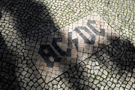 AC/DC name is seen on Portuguese pavement at the pavers school in Lisbon