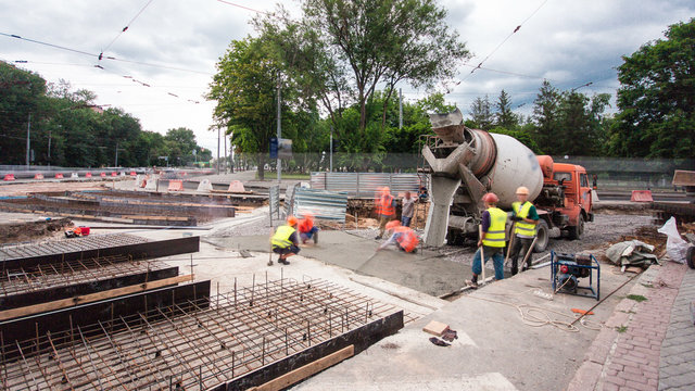 Concrete works for road maintenance construction with many workers and mixer timelapse