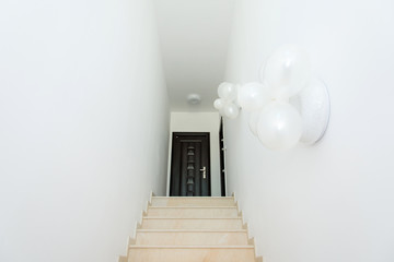 white corridor with stairs - selective focus, space for text
