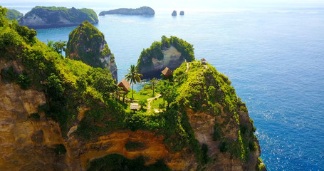 Jungle Tree Houses In Nusa Penida, Indonesia On Cliffs Overlooking Tropical Bay