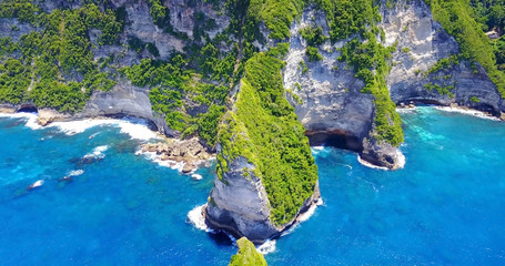 Aerial View Of Nusa Penida Banah Cliffs, Bali, Indonesia - Beautifual Tropical Coast With Rocky Cliffs Overlooking Turquoise Blue Cove