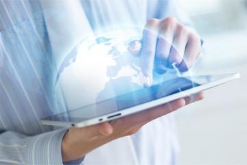 Man holding   digital tablet on background