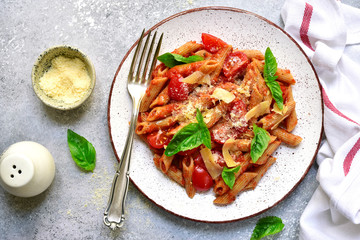 Penne pasta with tomato in red sauce.Top view with copy space.