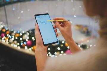 Woman writing on mobile phone