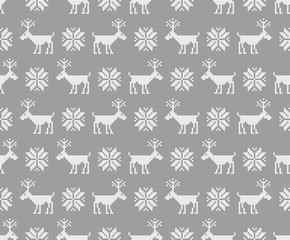 Seamless pattern with deers. Nordic background. Cross stitch. Scheme of knitting and embroidery. Winter ornament. Vector.