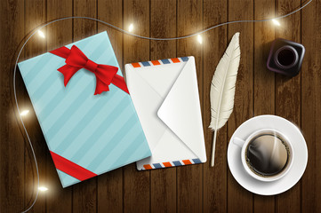 Gift box with a letter in an envelope and a cup of coffee.