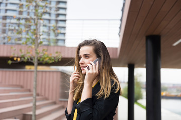 Young businesswman using mobile phone outdoor