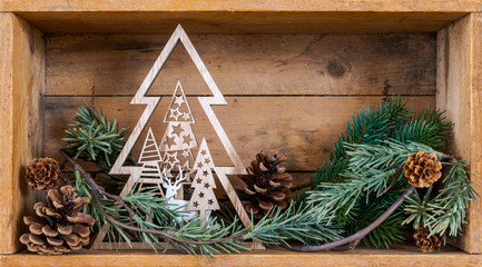 some Christmas decoration in an old wooden box