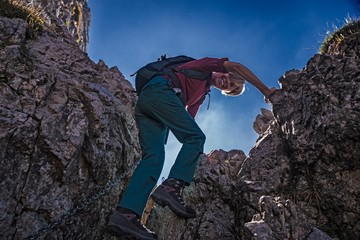 A mountaineer woman as she passes a rocky passage on the Southern Grigna.