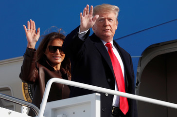 U.S. President Trump waves with the first lady as they depart for Argentina from Joint Base Andrews in Maryland