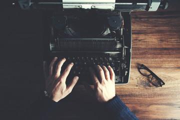 Typewriter with man hand