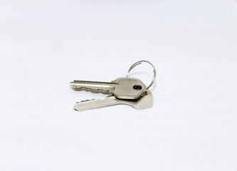 Two metal apartment keys isolated on the white background