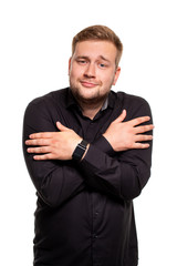 Guy on a white background freezes hugging myself