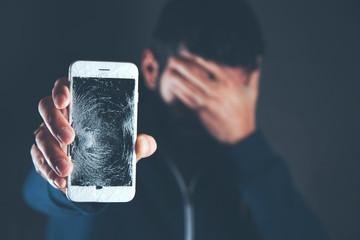 sad man hand broken phone
