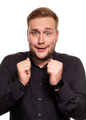 Emotion, advertisement and people concept - surprised man in black shirt over white background