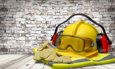 Safety helmet with earphones and goggles