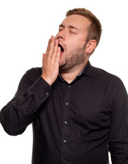 Portrait of caucasian yawning man. He is exhausted and tired because of a lot of work