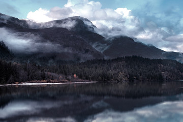 Foto op Canvas Donkergrijs mountain reflection in lake picture vintage style