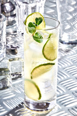 Caipirinha, Mojito cocktail, vodka or soda drink with lime, mint and straw on table
