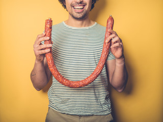 Happy man with big sausage
