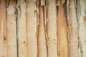 Fence from freshly sawn boards