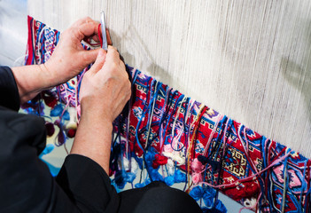 Woman working at the manufacture of carpets, Turkish rugs are one of the main economic sectors of the country