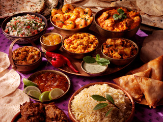 SELECTION OF COOKED INDIAN DISHES