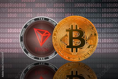 Bitcoin (BTC) and Tron (TRX) coin on the binary code