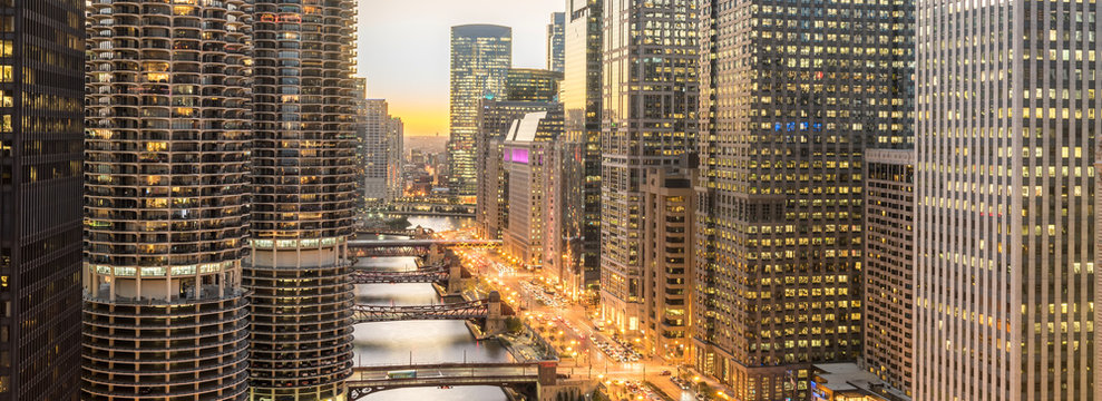 Panorama3 aerial view of skyline along Chicago river through downtown at sunset