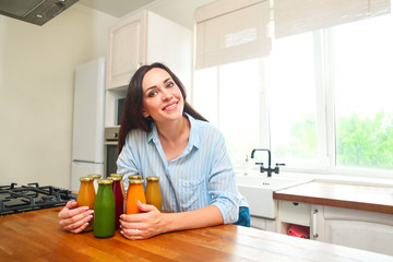 Diet nutrition with detox juice. Healthy woman posing with fresh juice bottles of  detox smoothie