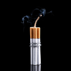 Dynamite made from cigarettes shows danger of smoking. Stop smoking concept