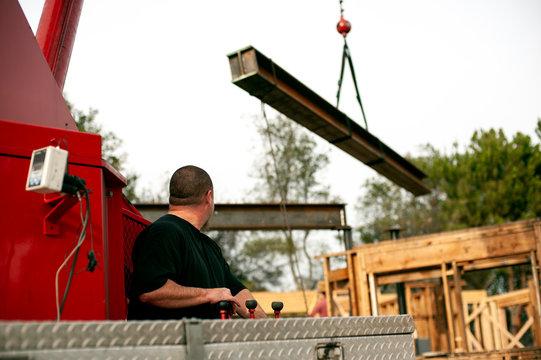 hoisting a steel I-beam with a crane