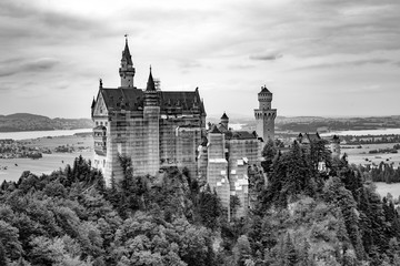 view of world-famous Neuschwanstein Castle under renovation on a cloudy day in Fussen, Bavaria