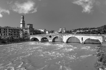 the old roman bridge in Verona  spans the river Etsch